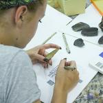 Student illustrates mock artifacts from a mock archeological dig