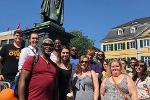 Students participating in the Summer 2018 music history study abroad program pose with the Beethoven Monument in Bonn, Germany.