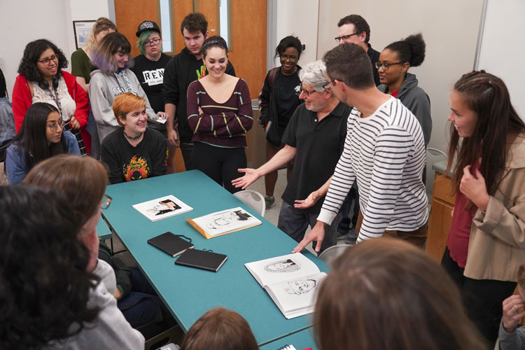 Joe Ciardiello shows is original illustrations to students at Kennesaw State University School of Art and Design