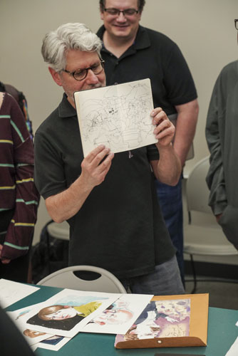 Illustrator Joe Ciardiello shows a spread from one of the many sketchbooks he shared in his presentation to students.